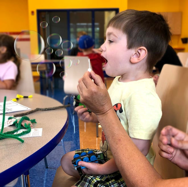 Zachary Lamb, 3, of Fond du Lac, learns to take deep breaths to blow bubbles as a stress coping mechanism at Children's Museum of Fond du Lac. A summer series, Mindfulness, Resiliency and Beyond, offers classes that help youth and adults build coping skills to help them reduce stress in light of increased mental and emotional health issues related to the pandemic.