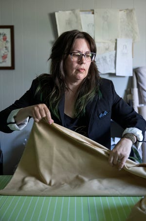 Lei Bretón works on a piece at Curvy Custom Bride in SoBro.