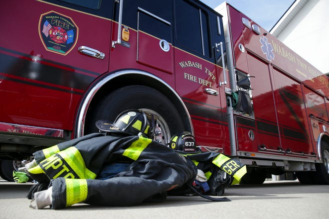 Turnout gear for a pair of fire fighters sits on the ground next to a Wabash Township Fire engine, Tuesday, June 22, 2021 in Wabash Township.