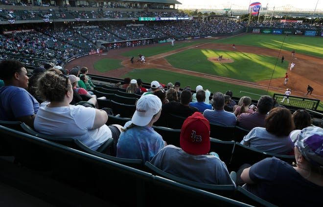 Over 10,000 spectators filled Slugger Field to watch the Louisville Bats play the Indianapolis Indians on the first day the stadium has allowed 100% capacity following coronavirus restrictions in Louisville, Ky. on June 22, 2021.