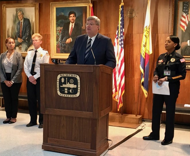 Memphis Mayor Jim Strickland speaks at a City Hall news conference on Wednesday, June 23, 2021, flanked by staffers including recently hired Memphis Police Chief Cerelyn Davis (right) and Memphis Fire Chief Gina Sweat (second from left.)