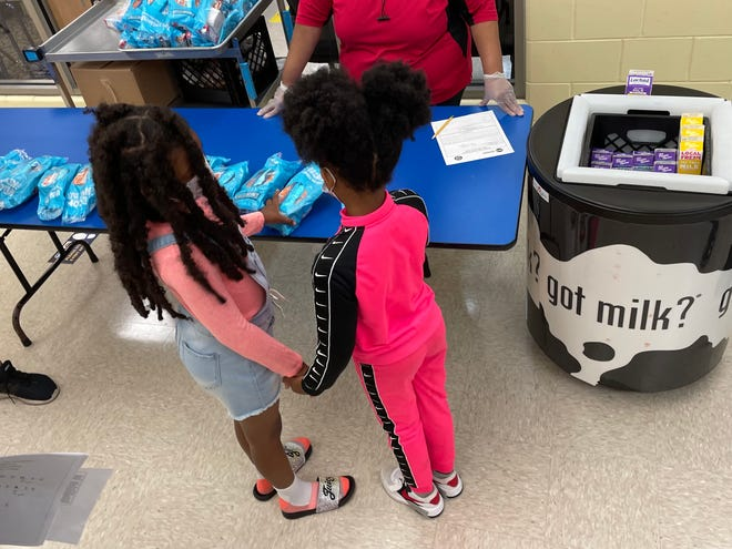 Students pick up cereal for breakfast at the Summer Academy program at Bethune Academy on Tuesday.