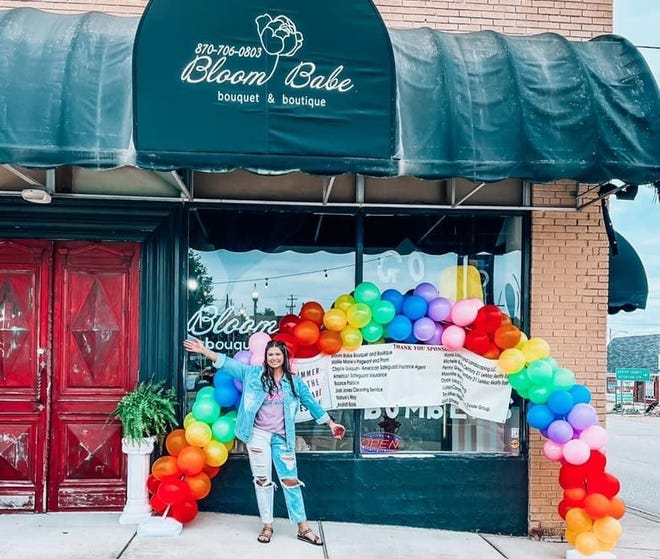 Brooke Grissum stands in front of her balloon display at the Summer on the Square Festival. The festival took place in Mountain Home's downtown square on Memorial Day.