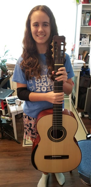 Paloma Chaprnka, who won her age division in the Houston Classical Guitar Festival and Competition
