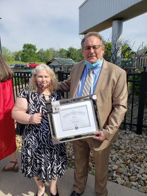 Bruce Piper receives his award from Kim Burgess, Secretary of the Aktion Club of Licking County.