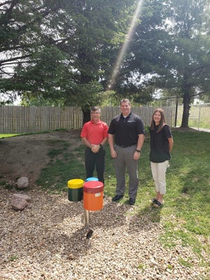 From left, Dale Lewellen, Licking County Educational Superintendent; Eric Baltzell, Garmann- Miller, and Dep Pegher, Flying Colors Preschool Director.