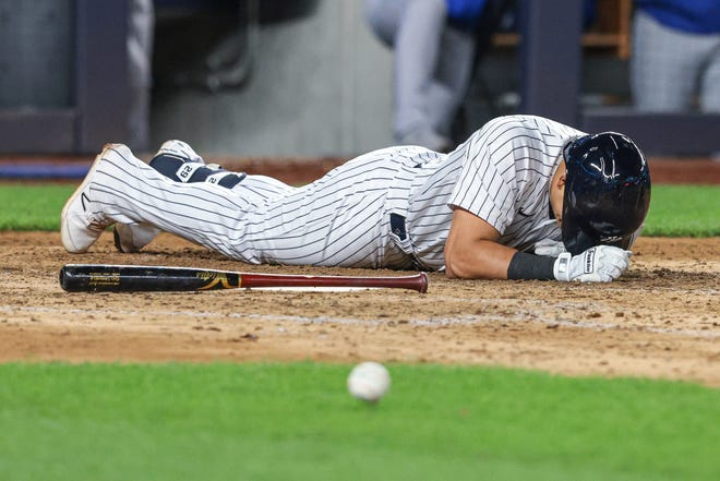 June 22, 2021; Bronx, N.Y. -- Yankees third baseman Gio Urshela (29) reacts after being hit by a pitch during the seventh inning against the Kansas City Royals at Yankee Stadium.
