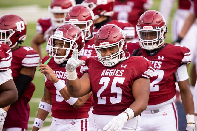 The New Mexico State Aggies football team vs the Dixie State Trailblazers at Sun Bowl Stadium, Sunday, March 7, 2021, in El Paso, Texas. Photo by Ivan Pierre Aguirre