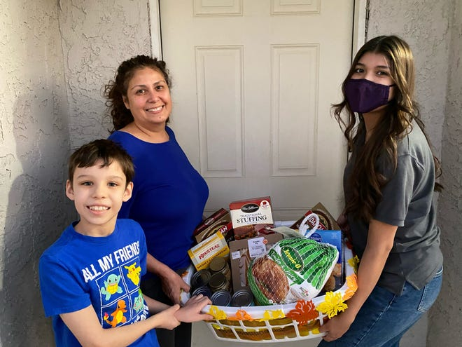 Students gave away baskets to families in the Grandparents Raising Grandkids program organized by the Riverside County Office on Aging.