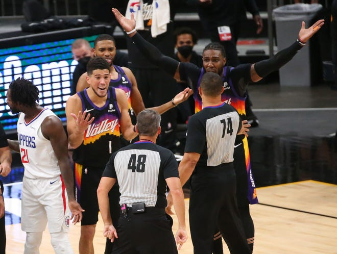 Jun 22, 2021; Phoenix, Arizona, U.S; Phoenix Suns guard Devin Booker (1) argues with referee Scott Foster (48) after a foul was called on forward Jae Crowder (99) against the LA Clippers during Game 2 at Phoenix Suns Arena June 22, 2021. Mandatory Credit: Michael Chow-Arizona Republic