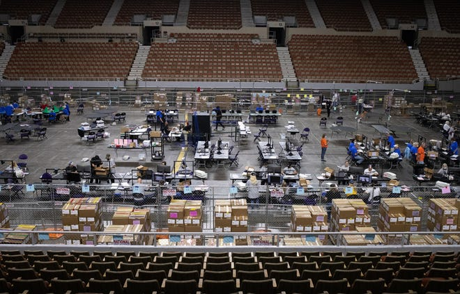 Maricopa County ballots from the 2020 general election are examined and recounted by contractors hired by the Arizona Senate on June 23, 2021, at the Veterans Memorial Coliseum in Phoenix.