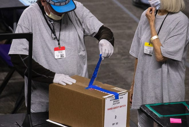 Maricopa County ballots from the 2020 general election are examined and recounted by contractors hired by the Arizona Senate on June 23, 2021, at the Veterans Memorial Coliseum in Phoenix. An elections expert says a similar process in Michigan would undermine faith in the state's elections, given that previous audits have affirmed Michigan's voting results in the November 2020 election.