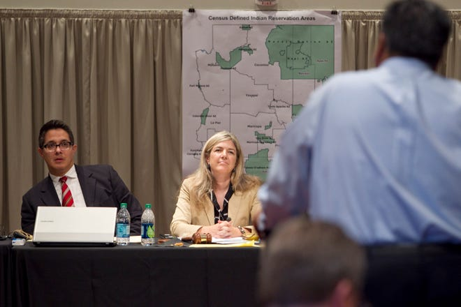 Vice Chairman Jose Herrera and Chairwoman Colleen Coyle Mathis listen to public comments during a 2011 Arizona Independent Redistricting Commission in Phoenix.