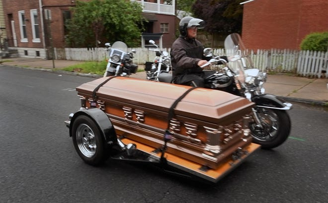 Al Skinner gives Roy A. Kleinfelter one last ride after his funeral service in Lebanon Tuesday. Skinner, of Wrightsville, who designed the trike platform 20 years ago, has give hundreds of final rides for motorcycle riders over the years saying 'you put them in the wind one last time'.