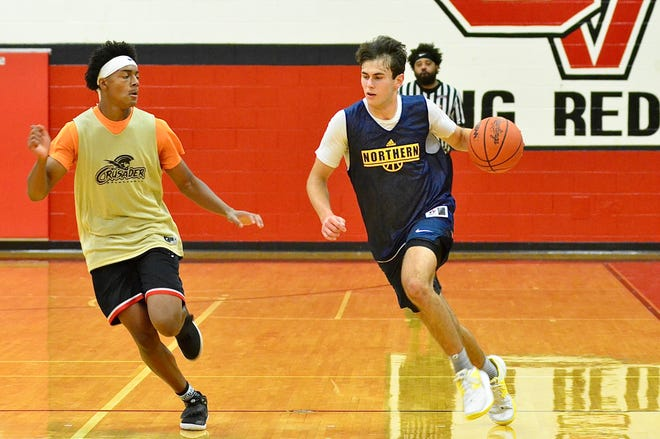 Port Huron Northern junior Tyler Jamison scrimmages against L'Anse Creuse North during a boys basketball summer league game Wednesday, June 23, 2021, at Chippewa Valley.