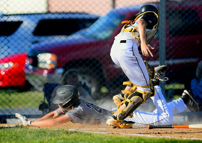 Northeastern's Quinn Shindler scores with Red Lion catcher Sam Koons taking the throw in American Legion baseball action at Manchester Field Wednesday, June 23, 2021. Bill Kalina photo