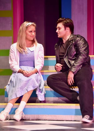 """Sandy (Sydney Sherry) and Danny (Blake Stallings) remember their summer at the beach in the Young Actors Theatre production of Grease,"""" which opens Friday, June 25, 2021."""