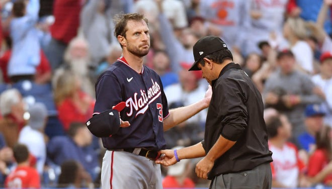 Max Scherzer has his belt checked after he pitched the first inning against the Phillies at Citizens Bank Park on Tuesday night. Peorian and former MLB pitcher Mike Dunne calls the new rule a 'disgrace.'