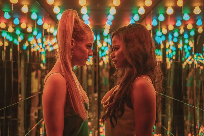 """Riley Keough, left, and Taylour Paige star in A24's """"Zola,"""" based on a viral Twitter story."""