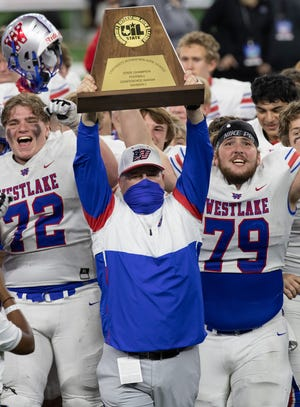Westlake head coach and athletic director Todd Dodge holds the championship plaque after the 52-34 win by Westlake over Southlake Carroll in the Class 6A Division I championship game in January. Westlake again placed in the top 10 of the UIL's final Class 6A Lone Star Cup standings.
