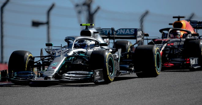 Mercedes driver Valtteri Bottas fends off Red Bull driver Max Verstappen during the 2019 Formula One U.S. Grand Prix auto race at Circuit of the Americas. The USGP returns to COTA on Oct. 24 for the first time in two years.