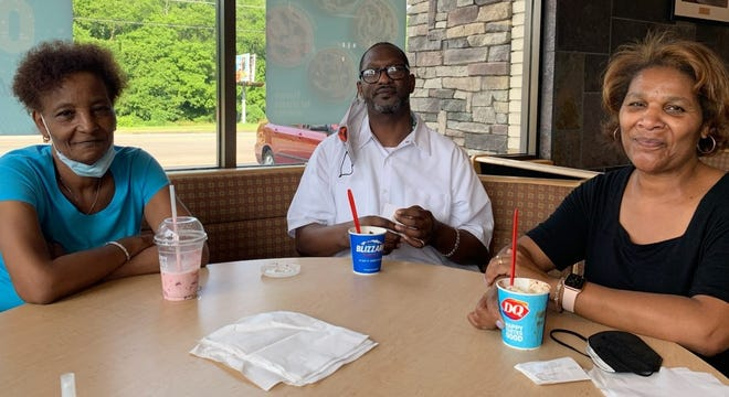 Spratt Howard, center, shown at a restaurant with his sisters, Carthinva Hayes, left, and April Rogers. Howard spent 25 years in prison for armed robbery until his recent release.
