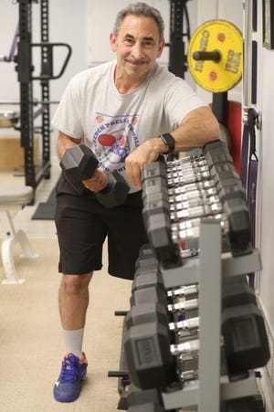 Dr. Larry Miller, a dentist and champion powerlifter, is starting a new business called Twinsburg Healthy Solutions aiming to provide exercise therapy and personal training services.