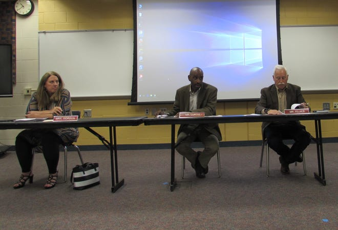 The Twinsburg school board listens to the plans for the 2021-22 school year during its June 23 meeting. Pictured from left are school board members Adrienne Gordon, Mark Curtis and Rob Felber.