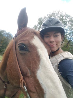 AdriAnne Snyder poses with her therapy horse, Tucker, on her dad's farm outside of Loudonville. A heart transplant recipient at age 2, She is now hopefully awaiting a kidney for transplant.