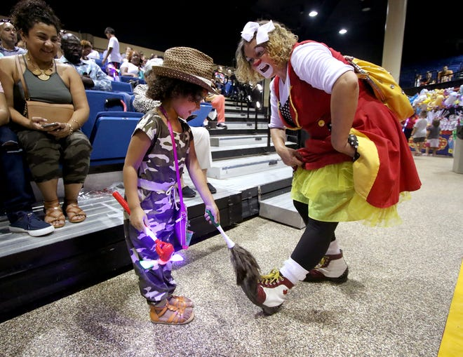 Sahara Brown, 5, dusts the shoes of Kozee the Clown at the Loomis Brothers Circus performance at Bradenton Area Convention Center in Palmetto, Fla., in this photo from 2019.