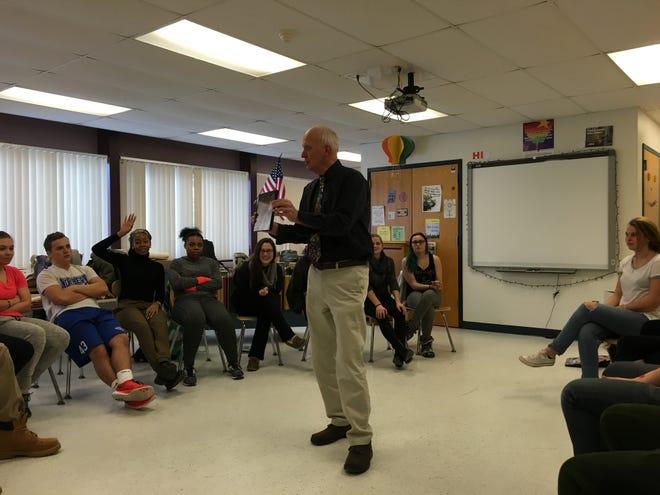 George Corcoran talks to students.