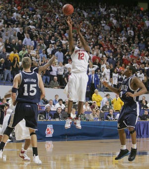 Ohio State's Ron Lewis, 12, goes up for three to send the second-round NCAA game against Xavier into overtime at Rupp Arena in Lexington, Kentucky, March 17, 2007. The Buckeyes pulled out the win 78-71. (Photo by Neal C. Lauron)