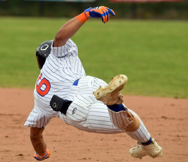Dominic Johnson of Hyannis tumbles over first after hitting a home run against Cotuit in their Cape League game on Monday night.