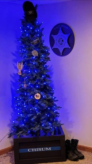 Pictured is the Chisum hero tree that stays lit up and blue throughout the entire year. Deputy Chisum's EOW (End of Watch) was two years ago, June 25.