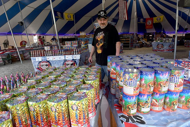 William Krueger of Fulton shops Thursday at the Spirit of '76 fireworks tent across from the Midway Travel Plaza. Some fireworks sellers are experiencing a shortage of stock because of the pandemic.