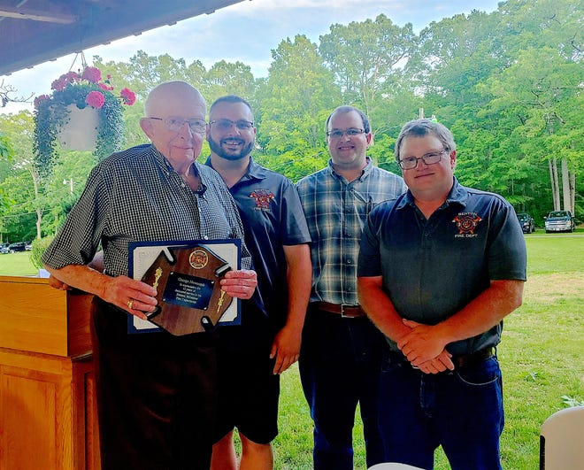 Benton Fire Department recently honored charter member George Newcomb for his 65 years of service. With him are Chief Brandon Palmisano,  1st Assistant Chief Eugene Martin, and 2nd Assistant Chief David Nielsen.