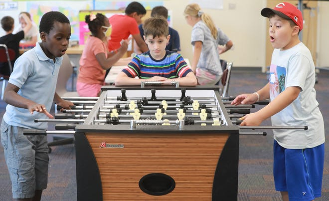 A group of 9-year-old boys play foosball at the New Albany Intermediate School summer day camp. From left is Michael Asomaning, Elijah Fisher, and Ian Berry. Central Ohio schools are preparing for students to return to a pretty normal school year in the fall, after more than a year of COVID restrictions, with many removing mask mandates after state orders were lifted earlier this month.