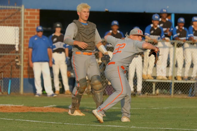 Randleman pitcher Ryan White throws to first as catcher Brooks Brannon looks on in the Tigers' 6-4 win over East Bladen in the 2-A East Regional championship game on Wednesday. [Kenneth Armstrong for The Courier-Tribune]