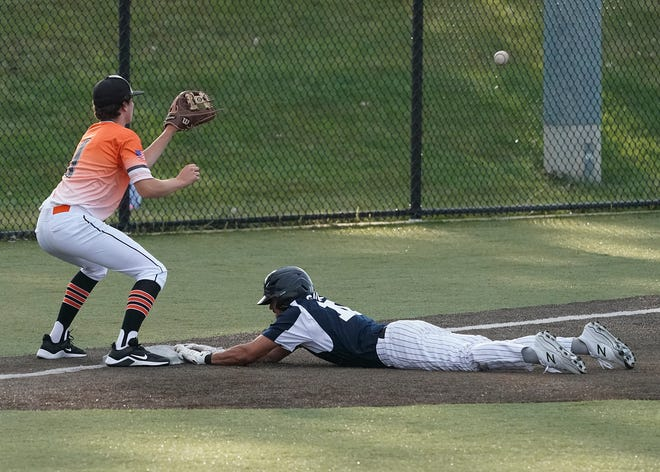 Adrian Post 275's Robert Gauna (Madison) slides in headfirst ahead of the throw to Hudson Post 180's Jacob Reincke (Morenci) during their Vets Night contest on Wednesday at Nicolay Field on the campus of Adrian College.