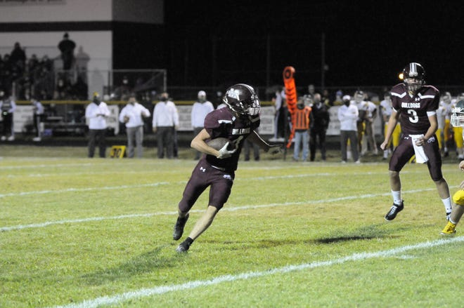 Morenci's Rodney Zimmerman runs with the ball during a game against Sand Creek in the 2020 season. [Telegram photo by Deloris Clark-Osborne]