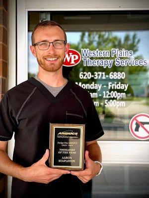 Aaron Stapleton of Western Plains Therapy Services was named Therapist of the Year by Dodge City AMBUCS through his contributions of therapy to the community.