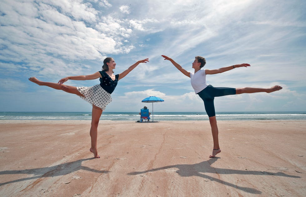 Noah Campbell, 14, along with his sister Savannah, 16,  demonstrates some ballet poses on the beach in Daytona Beach Shores, Thursday, June 24, 2021.