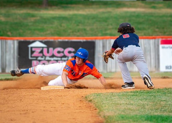 Blue Springs Post 499 Fike's Johnny Miles, left, avoids the tag to slide safely into second base in the first game of Wednesday's American Legion baseball doubleheader against Kansas City Teamwork Sports at Hidden Valley Park. Fike went on to a sweep with 13-3 and 11-10 wins.