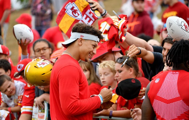 Kansas City Chiefs quarterback Patrick Mahomes signs autographs for fans after training camp at Missouri Western State University in St. Joseph in 2018. The Chiefs are returning to St. Joseph this year after relocating camp to Kansas City last year because of COVID-19 pandemic protcols.