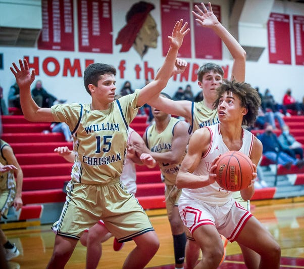 Fort Osage's Arthur Wyatt, right, looks for a way to the hoop during a game against William Chrisman last season. Wyatt, who led the Indians in scoring, rebounding and steals last season, is looking to take on a leadership role for his senior season this winter.