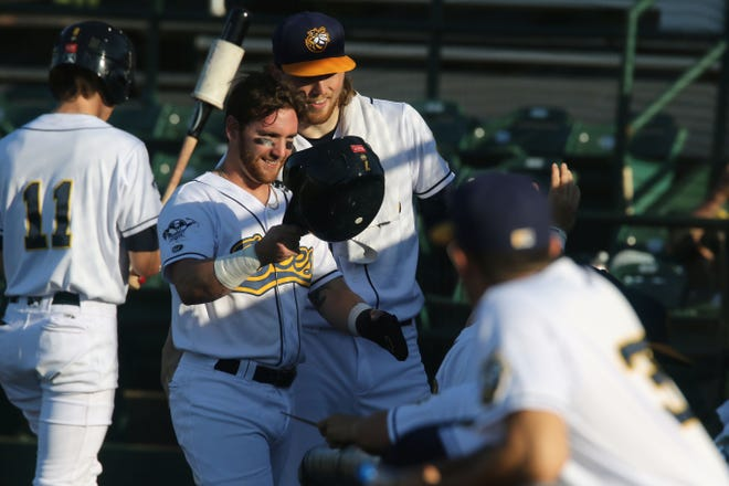 Burlington Bees Reid Halfacre (7) is congratulated by  teammates after scoring during their game against the Cape Catsish Wednesday June 23, 2021 at Community Field.