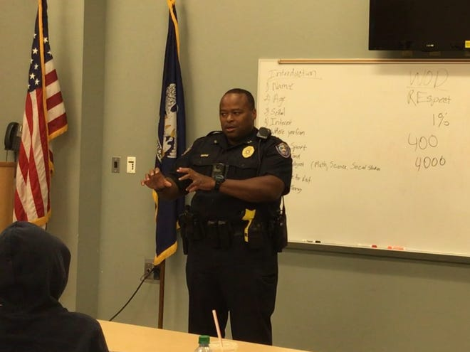 Officer Tyson Dennis discusses local police relations and the importance of proper communication on both sides with those in attendance at the summer mentoring sessions.