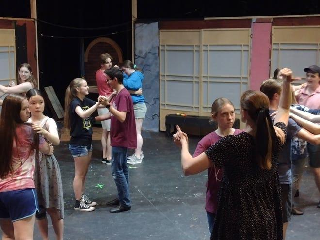 Theatricks cast for Cinderella practice dancing