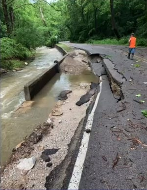 Storms damaged North Old Ind. 37 in June. The road goes through Lower Cascades Park.