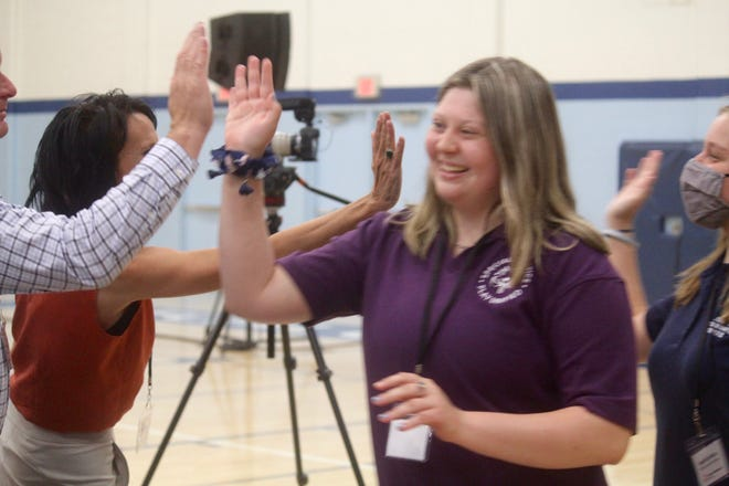 """Athletes and supporters greet during the Special Olympics Michigan """"Building Tomorrow's Champions"""" campaign announcement  event on Thursday, June 24, 2021, in Grand Rapids, Mich."""